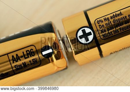 Close-up Of Two Aa Size Batteries With Plus And Minus Signs - Concept Of Energy And Positive And Neg