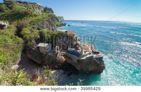 Ulu Watu coastline with beaautiful rocky cliffs and turquoise wavey sea.