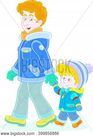 Young Dad And His Little Son Friendly Talking And Walking Together Hand In Hand On A Winter Stroll,