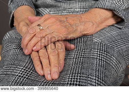 Close Up Picture Of Old Woman Trembling Wrinkled Hands