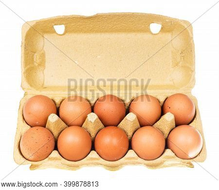 Ten Brown Chicken Eggs In Yellow Cardboard Container Isolated On White Background