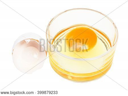 Broken Chicken Egg In Glass Bowl And Empty White Shell Isolated On White Background