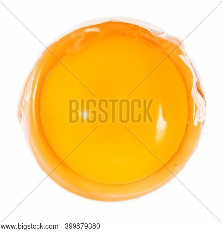 Top View Of Separated Egg Yolk In Half Of Shell Close Up Isolated On White Background