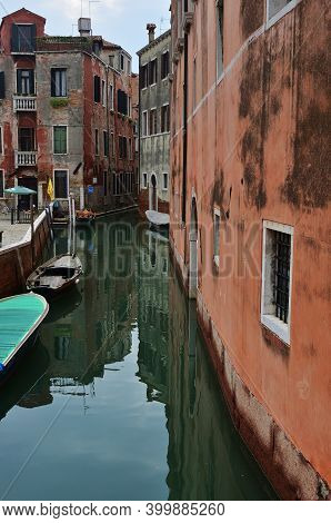 Venice Canal At Sunset. Tourists From All The World Enjoy The Historical City Of Venezia In Italy, F
