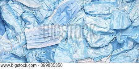 Used Mask Background. Disposal Coronavirus. Trash Mask. Covid-19 Waste. Rubbish. Discarded. Medical