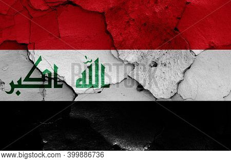 Flags Of Iraq And Yemen Painted On Cracked Wall