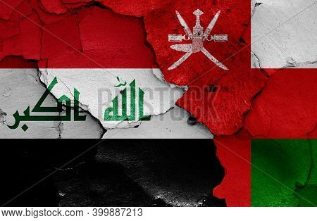 Flags Of Iraq And Oman Painted On Cracked Wall