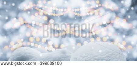 Abstract Christmas Tree Background With Snow Bokeh Garland Lights And Snowdrift In Winter