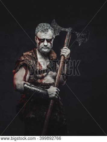 Mythical Medieval Fighter With White Skin In Light Armour Armed With Two Handed Axe Posing In Dark B