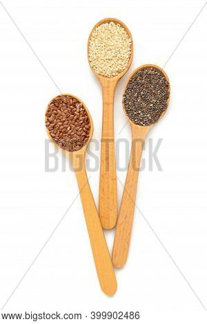 Healthy Superfood: Sesame, Sunflower Seeds, Flax Seeds And Chia Isolated On White. Seeds On Spoon To