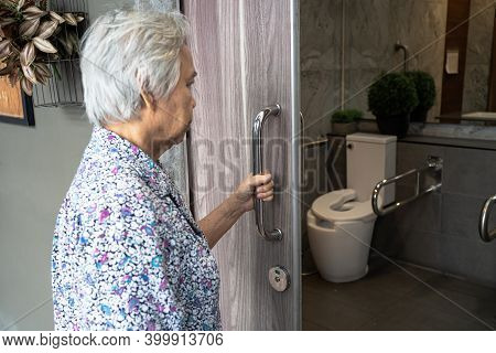 Asian Senior Elderly Old Lady Woman Patient Open Toilet Bathroom By Hand In Nursing Hospital Ward, H