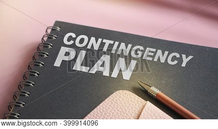 Contingency Plan Words On Upper Page Of Copybook, Pen And Pink Leather Wallet. Business Crisis Conce