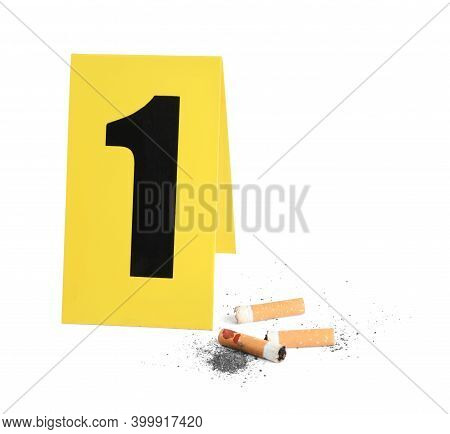 Cigarette Stubs And Crime Scene Marker With Number One Isolated On White