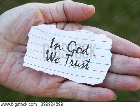 In God We Trust Note In Hand.