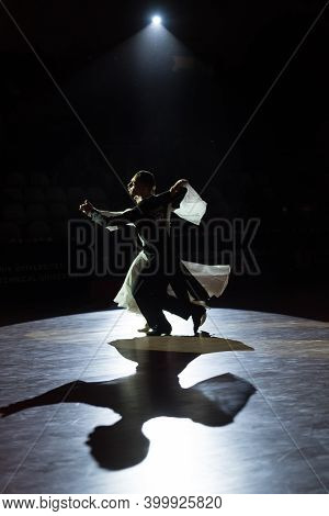 A Beutiful Photo Of A Dancing Couple At A Wdsf Ballroom Competition
