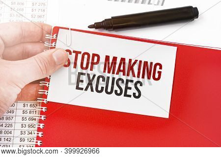 Business Man Holding A Red Notebook And White Card With Text Stop Making Excuses. Financial Concept