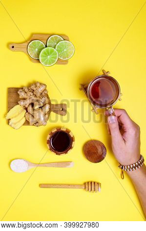 Tea Drink Lime Honey Ginger Raw Root. Dry Ginger. Yellow Background. Flat Lay