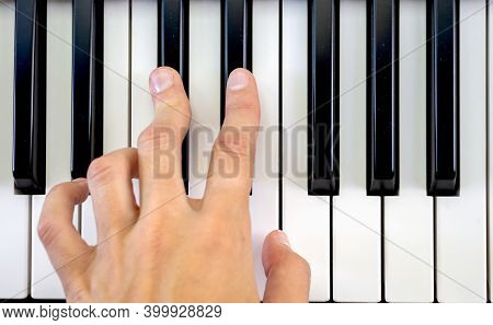 Fingers Play Chords On Piano Keys Playing Synthesizer Pianist Music Hobby Top View.