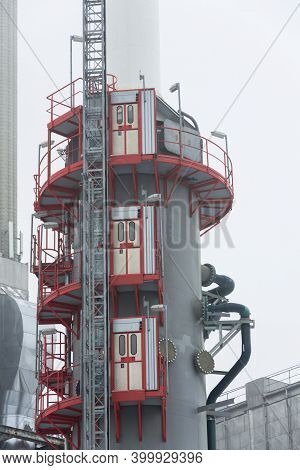 Chimney At Heating Plant Covered In Fog, Cloudy Winter Day, Low Angle View, Energy Production, Air P