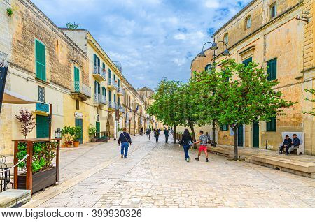Matera, Italy - May 6, 2018: Stone Street With People Tourist Walking Down And Buildings In Matera T