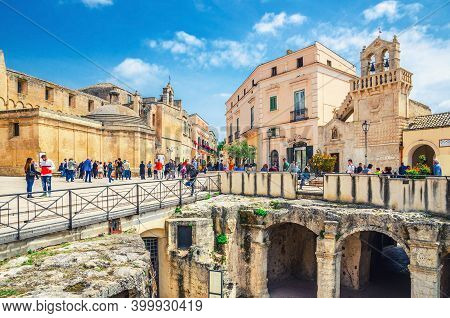 Matera, Italy - May 6, 2018: People Tourists Walking Down Piazza Vittorio Veneto Square With Church