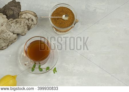 Healing Natural Tea, Coffee And Pieces Of Birch Chaga In A Glass Cup On A Light Background. Naturopa