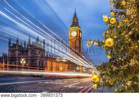 Big Ben With Christmas Tree On Bridge In The Evening, London, England, United Kingdom