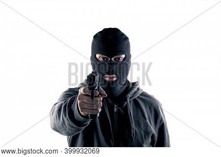 Criminal wearing black balaclava and hoodie with a gun isolated on white with clipping path