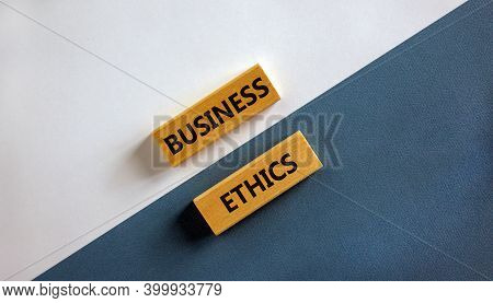 Business Ethics Symbol. Wooden Blocks With Words 'business Ethics'. Beautiful White And Blue Backgro
