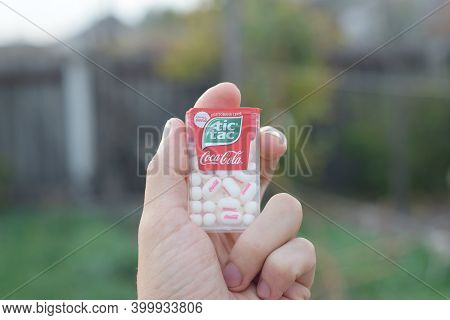 Tic Tac Candy Package With Coca-cola Taste In Male Hand. Tic Tac Is Popular Due Its Minty Fresh Tast