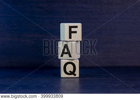 Faq Symbol. Concept Word 'faq - Frequently Asked Questions' On Wooden Cubes On A Beautiful Dark Grey