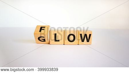 Be Glow Or In The Flow. Turned A Cube And Changed The Word 'slow' To 'glow'. Beautiful White Backgro