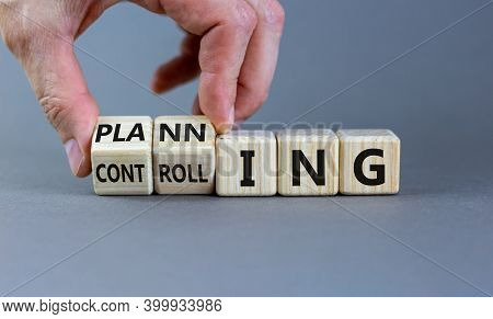 Planning Or Controlling Symbol. Male Hand Flips Wooden Cubes And Changes Words 'planning' To 'contro