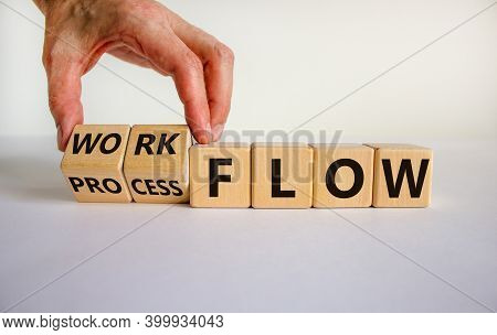 Workflow Or Process Flow Symbol. Male Hand Flips Wooden Cubes And Changes Words 'process Flow' To 'w