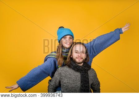 Happy Couple In Warm Clothes. Couple In Love. Fashionable Man With Scarf And Hat In Autumn Or Winter