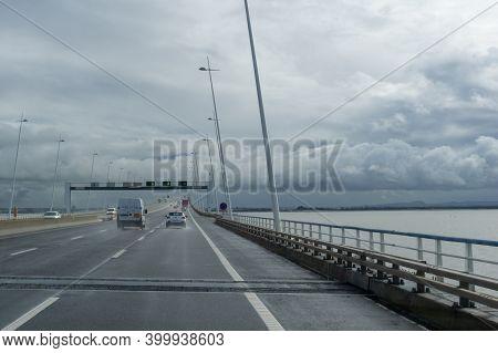 Cars Crossing The Vasco Da Gama Bridge In Lisbon On A Rainy And Overcast Day