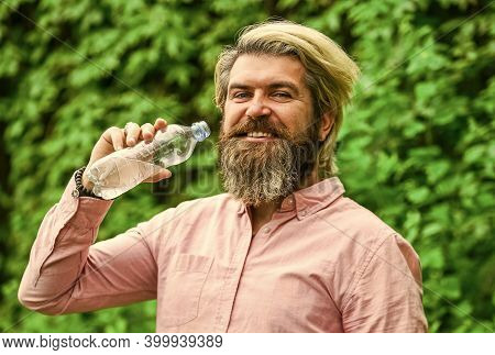 Soda Water. Water Balance. Man Bearded Tourist Drinking Water Plastic Bottle Nature Background. Summ