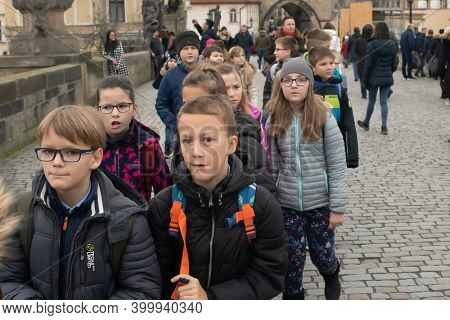 Prague, Czech Republic. 01-11-2020. Tourists Are Walking On The Charles Bridge On The Historical Tow