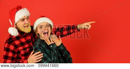 Santa Claus Style. Having Fun. Christmas Time. Man And Woman Christmas Holiday Celebration. Family S