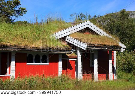 Norway Sod Roof Traditional Log Cabin. Norwegian Traditional Architecture In Setesdalen Valley Of Ag