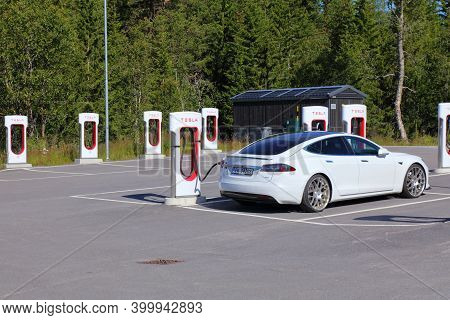 Hovden, Norway - July 31, 2020: Tesla Motors Electric Cars Parked At Chargers Of A Tesla Charging St
