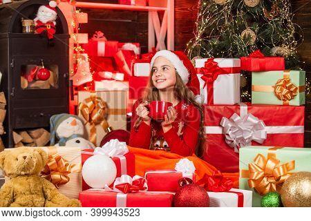 Expecting Santa. Christmas Sale. Santa Helper Drink Milk. Smiling Shop Assistant. Kid In Santa Hat W