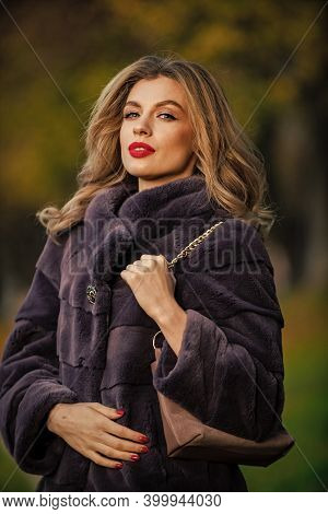 Luxury And Success Concept. Benefits To Wearing Fur. Elegant Woman Wear Fur Coat. Beauty And Fashion