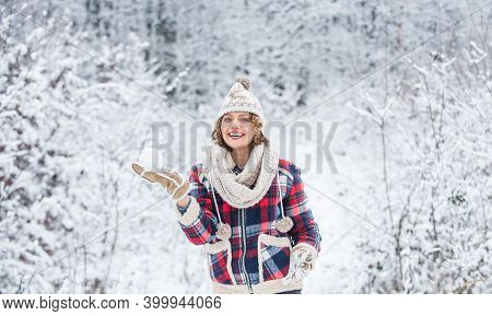 Walk In Snowy Forest. Cheerful Emotional Girl Having Fun Outdoors. Winter Outfit. Woman Wear Warm Ac