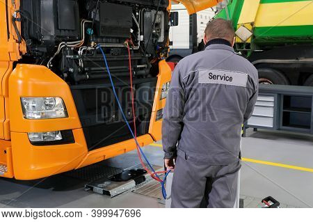Truck On Computer Diagnostics In A Car Service. Servicing And Repairing Trucks In A Large Garage. Ca