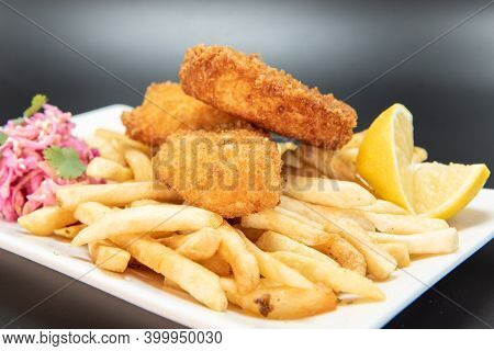 Breaded Halibut Fish And Chips Served With French Fries And Lemon Garnishment For A Plate Of Delicio