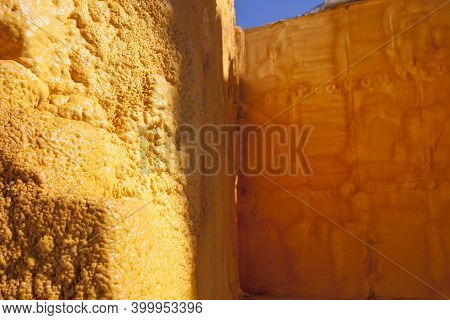 External Insulation Of House Walls With Yellow Sprayed Polyurethane Foam. Selective Focus
