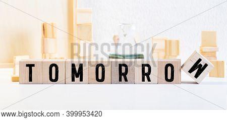 Tomorrow Word Written On Wood Block, Concept