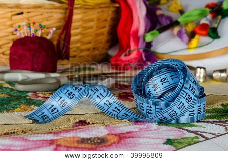 tapemeasure on a background set for cross stitching