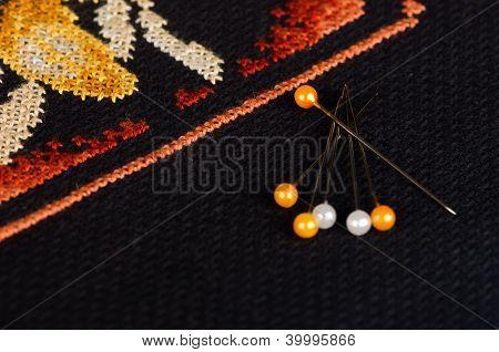 Few pins on the black cross stitching